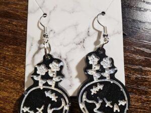 skull with flowers resin earrings